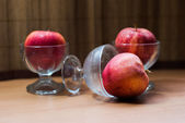 Still life with three red applesa in glass of ice cream — Stock Photo