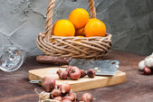 Shallots , Onion , Garlic , Chopping board , Knife , Orange with — Stock Photo