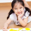 Little Asian child drawing on paper — Stock Photo