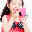 Little Asian child with makeup accessories — Stock Photo
