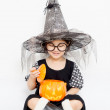 Surprise Happy witch child with pumpkin in Halloween dress — Stock Photo