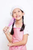 Little Asian cute chef wearing pink apron thinking action — Stock Photo