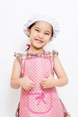 Happy little Asian cute chef wearing pink apron — Stock Photo