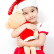 Little Asian girl huging bear doll on christmas isolated in white — Stock Photo