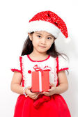 Little Asian girl holding red gif box on christmas isolated in white — Stock Photo