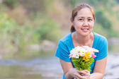 Happy Asian women with flower — Stock Photo