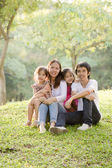 Happy Asian family in park — Stock Photo