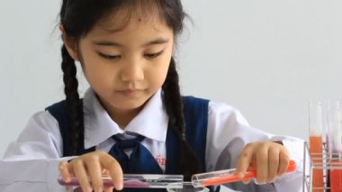 Little Asian student making science experiments. Education. — Stock Video