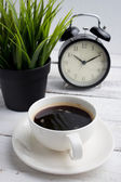 Cup of coffee with clock — Stock Photo
