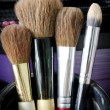 Stock Photo: Old makeup brushes in holder