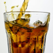 Dramatic cola splash, there is some movement in the splashes — Stock Photo