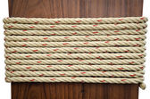 Stack of Rope on Brown wood with white background — Stock Photo