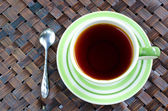 Cup of tea with spoon on bamboo wease background . — ストック写真