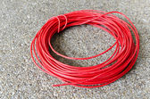 Red hot power cable on sand floor — Stock Photo