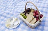 Pic-nic basket with fruit — Stock Photo
