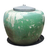 Big green jar with metal top cpver — Stock Photo