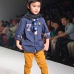 THAILAND, BANGKOK- OCT 2013 : A model walks the runway at the IK — Stock Photo #33046361