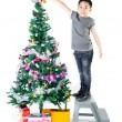 Asian cute boy with gift box ,decorate Christmas tree . — Stock Photo