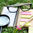 Office supplies Notebook paper and glasses — Photo