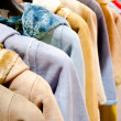 Stack of casual coat on hangers — Stockfoto