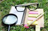 Office supplies Notebook paper and glasses — Stock Photo