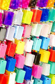 MultiColor plastic mobile phone cases on hangers — Stock Photo
