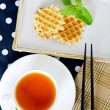 Top view of Tea with waffle and chopsticks in ceramic plate  — Stock Photo