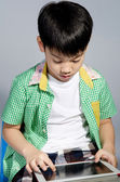 Little asian boywith tablet computer — Stock Photo