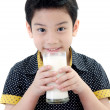 Photo: Portrait of Little asiboy drinking glass of milk