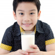 Foto Stock: Portrait of Little asiboy drinking glass of milk