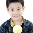 Photo: Cute boy with apple on white background