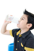 Portrait of Little asian boy drinking a glass of milk — Stock Photo