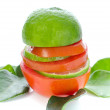 Stack of Lime and Tomato slices with green leaf on white backgro — Stock Photo #38329063