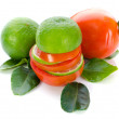 Stack of Lime and Tomato slices with green leaf on white backgro — Stock Photo #38329095