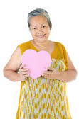 Asiatiska senior kvinna med en presentförpackning — Stockfoto