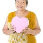 Asian Senior woman holding a gift box — Stock Photo #38745453