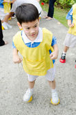 Asian cute boy playing in the park — Foto Stock