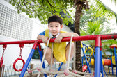 Asian cute boy playing in the park — 图库照片