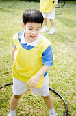 Asian cute boy playing in the park — Stockfoto