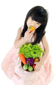 Young asian cute girl with vegetable — Stock Photo
