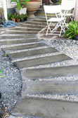 Concrete walkway in garden — Stockfoto