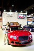 BANGKOK - MARCH 29 : Unidentified model with BENTLEY Continantal — Stockfoto