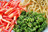 Fresh green pepper and red pepper chilli slide — Stock Photo
