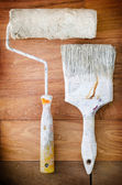 Paint brush on timber deck — Stock Photo