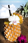 Pineapple juice with orchid in fresh fruits  — Stockfoto