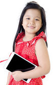 Little asian girl smiles with tablet computer  — Stockfoto
