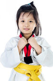 Little asian girl in a kimono with a yellow sash  — Stock Photo