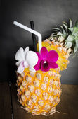 Pineapple juice with orchid in fresh fruits  — Stock Photo