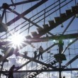 Families play on large gorilla climb ropes course silhouette 3 — Stock Video