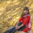 Young beautiful girl warm autumn — Stock Photo